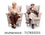 seniors seated in armchairs... | Shutterstock . vector #717833251