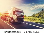 big white truck on the road in... | Shutterstock . vector #717834661