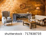 home comfort. armchair near the ... | Shutterstock . vector #717838735