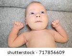 newborn naked baby boy with... | Shutterstock . vector #717856609