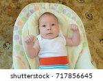 newborn naked baby boy with... | Shutterstock . vector #717856645