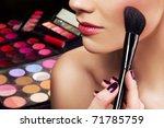 makeup artist applying blusher | Shutterstock . vector #71785759