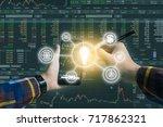 double exposure of hand holding ...   Shutterstock . vector #717862321