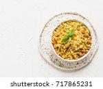 top view of cauliflower rice... | Shutterstock . vector #717865231