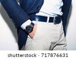 men suit perfect to the last... | Shutterstock . vector #717876631
