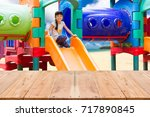 asian kid and plastic slide on... | Shutterstock . vector #717890845