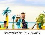handsome smiling latin american ... | Shutterstock . vector #717896047