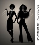 silhouettes of two girls...   Shutterstock .eps vector #717896731