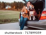 woman and dog with shawls sits... | Shutterstock . vector #717899359