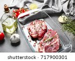 baking dish with fresh raw... | Shutterstock . vector #717900301
