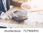businessman accountant or... | Shutterstock . vector #717906991