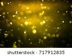 gold light on bokeh abstract... | Shutterstock . vector #717912835