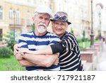 happy friendly senior couple... | Shutterstock . vector #717921187