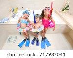little children in swimsuits... | Shutterstock . vector #717932041
