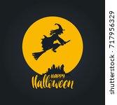 happy halloween lettering with... | Shutterstock .eps vector #717956329
