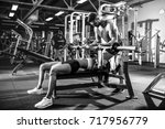 sporty girl doing weight... | Shutterstock . vector #717956779