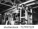 woman doing pull ups on... | Shutterstock . vector #717957229