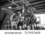 young fitness woman doing... | Shutterstock . vector #717957649