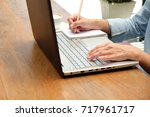 hand using tablet and writing... | Shutterstock . vector #717961717