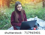 woman working or studying on... | Shutterstock . vector #717965401
