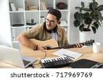 concentrated young musician... | Shutterstock . vector #717969769