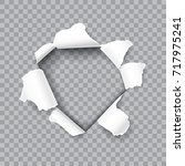 torn hole in the sheet of paper ...   Shutterstock .eps vector #717975241
