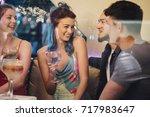 friends are enjoying drinks in... | Shutterstock . vector #717983647