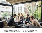 group of business people are... | Shutterstock . vector #717983671