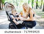 young fitness mother exercising ... | Shutterstock . vector #717993925
