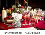a christmas table is laid with... | Shutterstock . vector #718014685