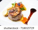 beef fillet with potato gratin... | Shutterstock . vector #718015729