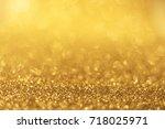 glittery golden background   Shutterstock . vector #718025971