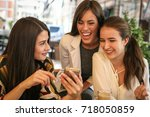 three young woman sitting in... | Shutterstock . vector #718050859