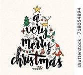 christmas vector lettering... | Shutterstock .eps vector #718054894