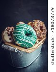 sweet glazed donuts in the... | Shutterstock . vector #718073779