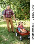 grandfather with granddaughter... | Shutterstock . vector #718077649