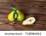 pears fruits on old wooden... | Shutterstock . vector #718086061