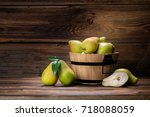 fresh pears with leaves in a... | Shutterstock . vector #718088059