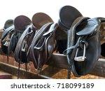 Rider Leather Saddles On Fence...