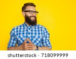 young bearded man in checkered... | Shutterstock . vector #718099999