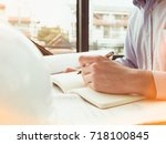 architect working on blueprint  ... | Shutterstock . vector #718100845
