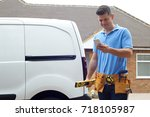 builder with van texting on...   Shutterstock . vector #718105987