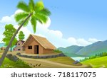 a small village next to a river ... | Shutterstock .eps vector #718117075