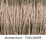 solid braided white and red... | Shutterstock . vector #718126009