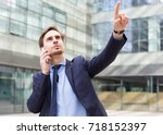 portrait of young businessman... | Shutterstock . vector #718152397