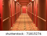 Hotel Hallway With Red Doors...
