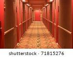 Hotel Hallway With Red Doors...