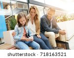 family on shopping day in mall  ... | Shutterstock . vector #718163521