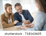 mature couple meeting real... | Shutterstock . vector #718163605