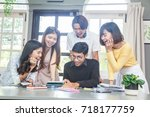young people meeting in the... | Shutterstock . vector #718177759